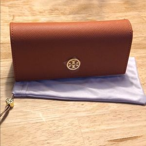 Tory Burch glasses case with matching sleeve.